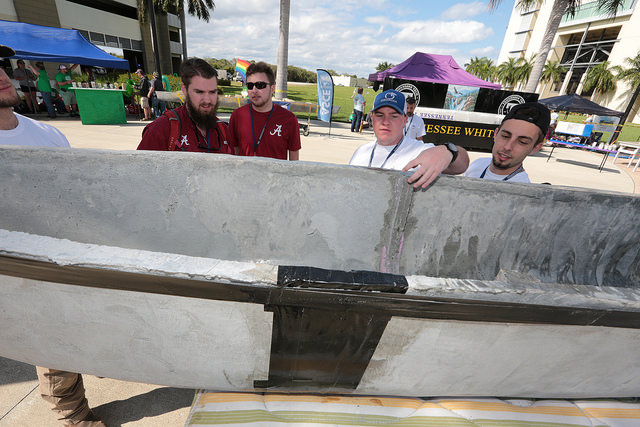 Students outside with cement canvas