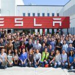 huge group photo outside the Tesla building