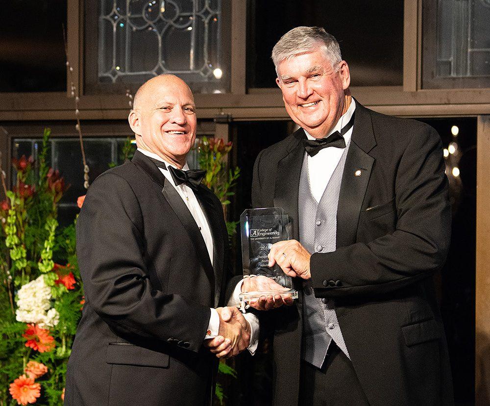 Dean Karr giving Bob Barnett his award