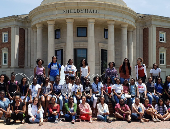 Cropped group picture of black women outside Shelby Hall
