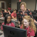 UA students help kids in a computer lab