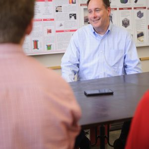 Lightfoot talks to students in a lab,