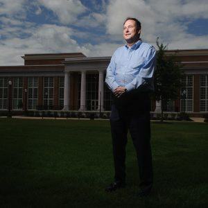 Robert Lightfoot stands on the grass outside of The Ferg.