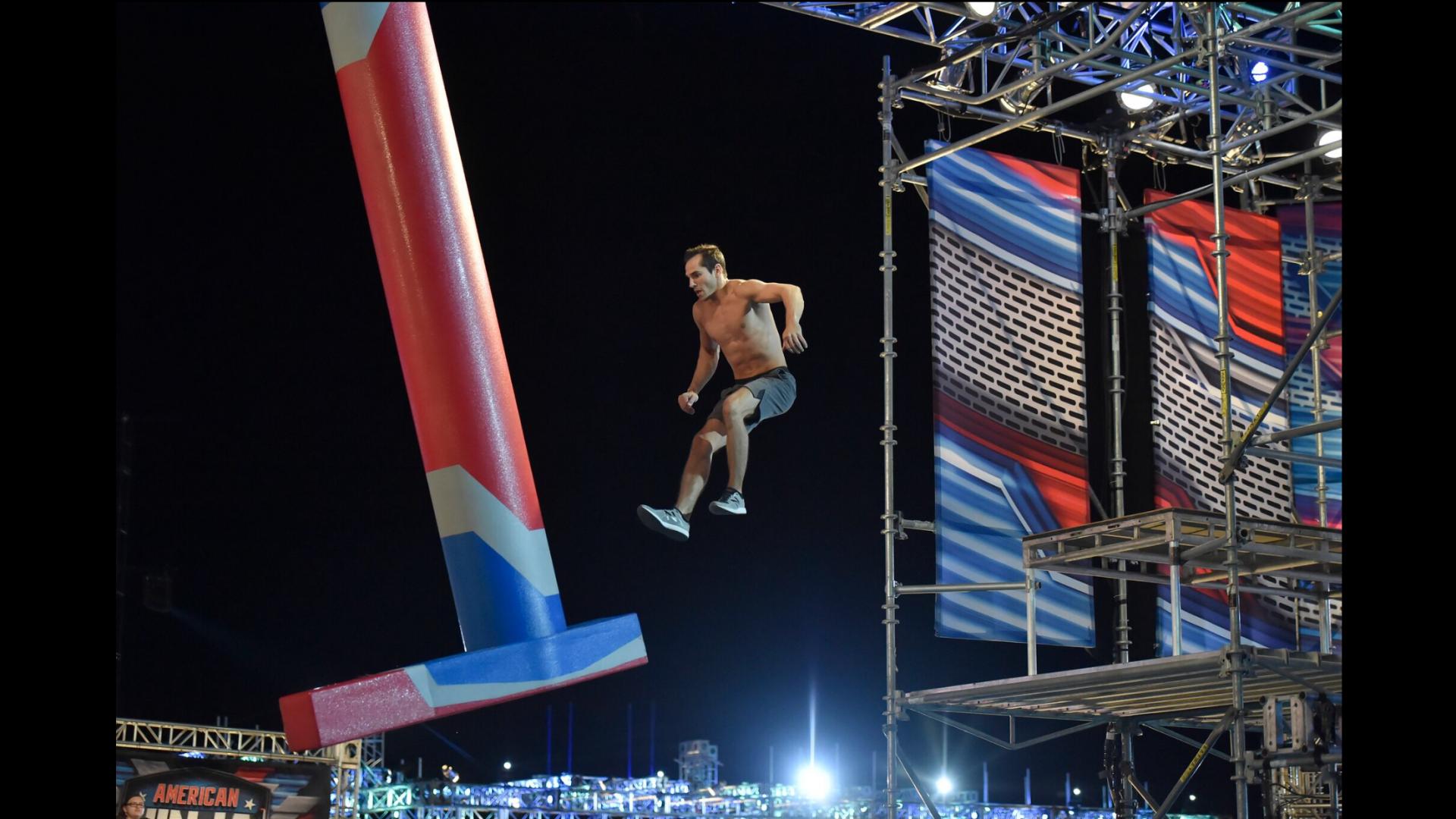 Casey Suchocki jumping off a platform