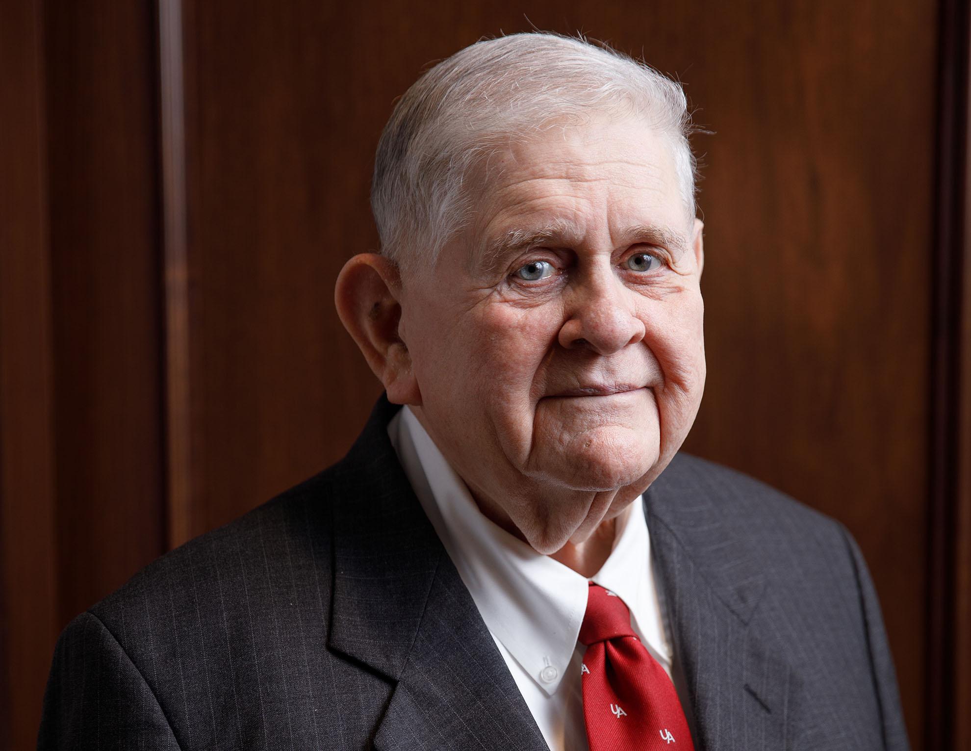 Older gentleman with red tie.