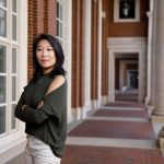 Lauren Pan stands in a hall outside Shelby