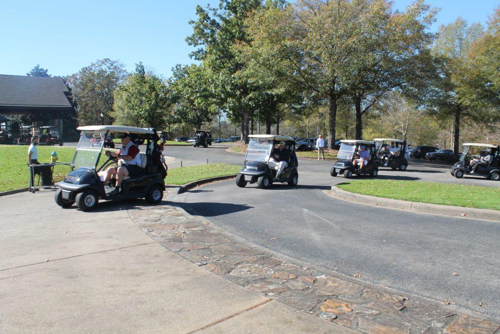 golf carts driving single file