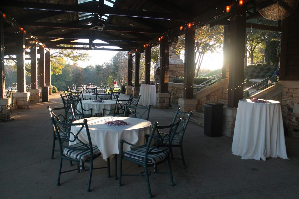 round tables covered in white table cloths spaced out on veranda