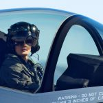 A woman pilot in the cockpit of a fighter jet