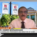 News screen capture of Dr. Moradkhani with a zoom background showing the Ferg Center